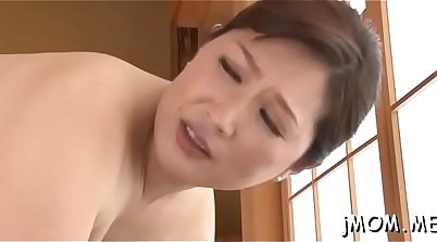 Cute Asian nymph gets her pussy vibed with fists