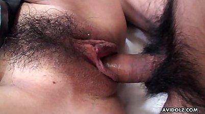 Hairy asian slut fucked by strap